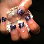 Purple Nail Art Design Grabbing Diamond